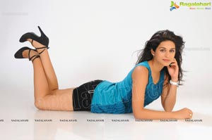 Shraddha Das in Sleeveless Blue Top and Black Short Skirt Photos