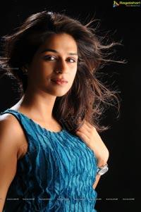 Shraddha Das in Sleeveless Blue Top and Black Short Skirt Photos