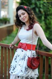 Tamanna in Sleeveless Belted Waist Dress