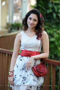 Tamanna in Sleeveless Belted Waist Dress